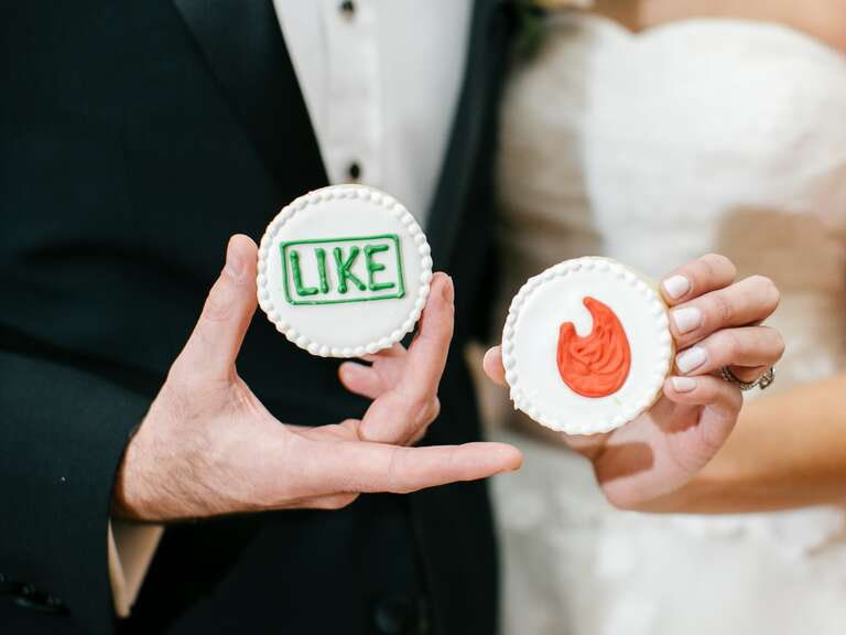 Tinder-themed sugar cookies with app-themed icons at a wedding.