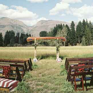 Camp wedding canoe ceremony arch