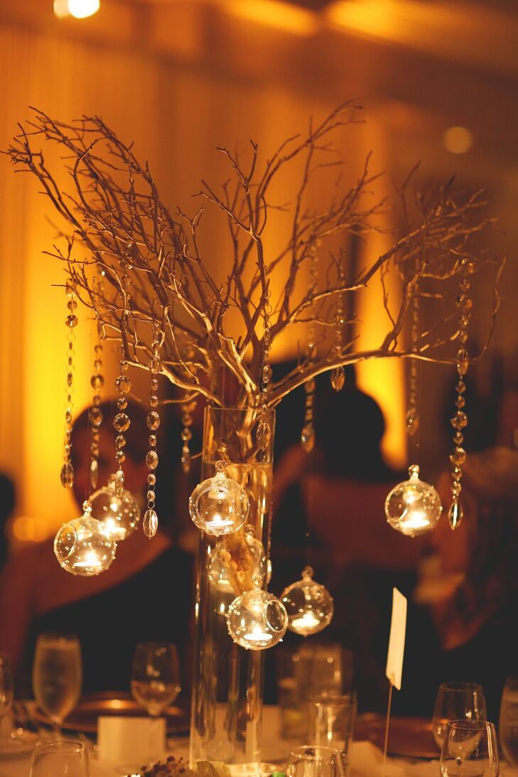 Hanging tea light and gold branch centerpieces