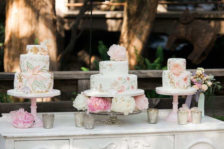 Joanie and Leigh's Cakes showed off their artistic aptitudes by creating not one, but three hand-painted confections. The one, two and three-tiered cakes featured layers of ivory fondant decorated with pink and gold floral flourishes and were displayed atop pretty pink cake stands.