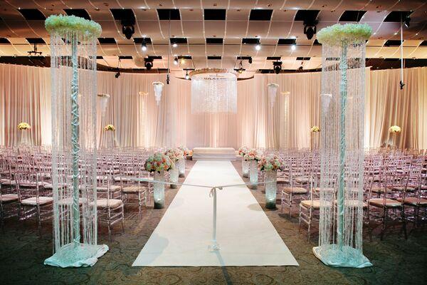 Elegant Drapery At Indoor Ceremony: Peach Bridal Bouquet