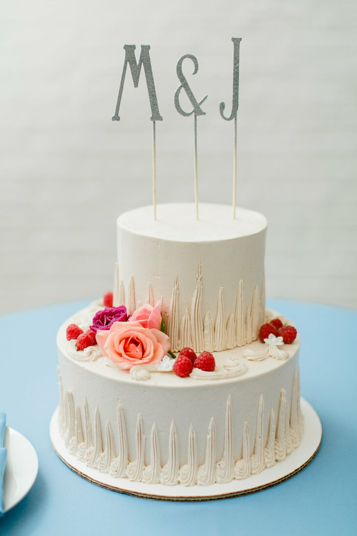 Because the couple served other desserts, the chocolate, raspberry and hazelnut two-tier cake was deliberately kept small and simple. Mary made the cake topper using the couple's initials.