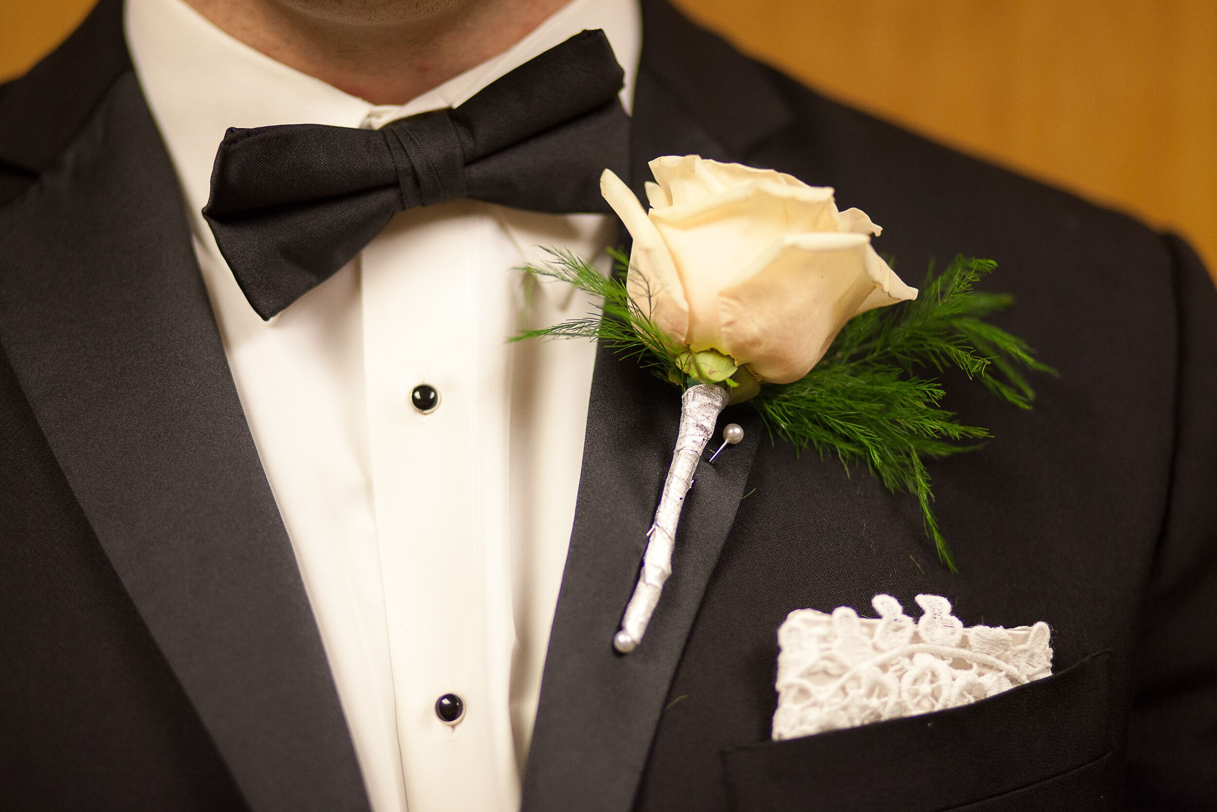 Groom With Rose Boutonniere And Lace Pocket Square
