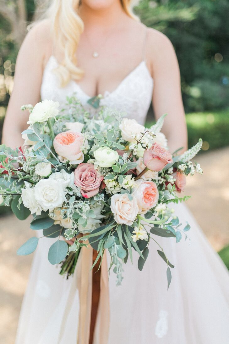 "For a wild, garden-fresh bouquet, the Little Branch florist created a robust bouquet with blush and cream garden roses, anemones, ranunculus and silver dollar eucalyptus. ""I wanted the overall style to be loose, organic and slightly wild with an elegant spin,"" Cassidy says."