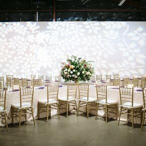 X Shaped Banquet Tables And Gold Chiavari Chairs