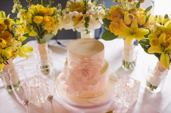 Two-Tiered White Wedding Cake with 3-D Flower
