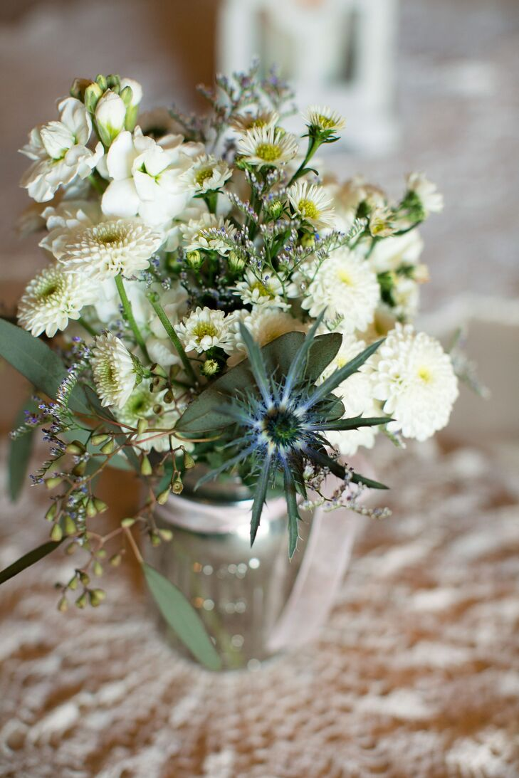 White mums blue thistle wedding reception centerpieces