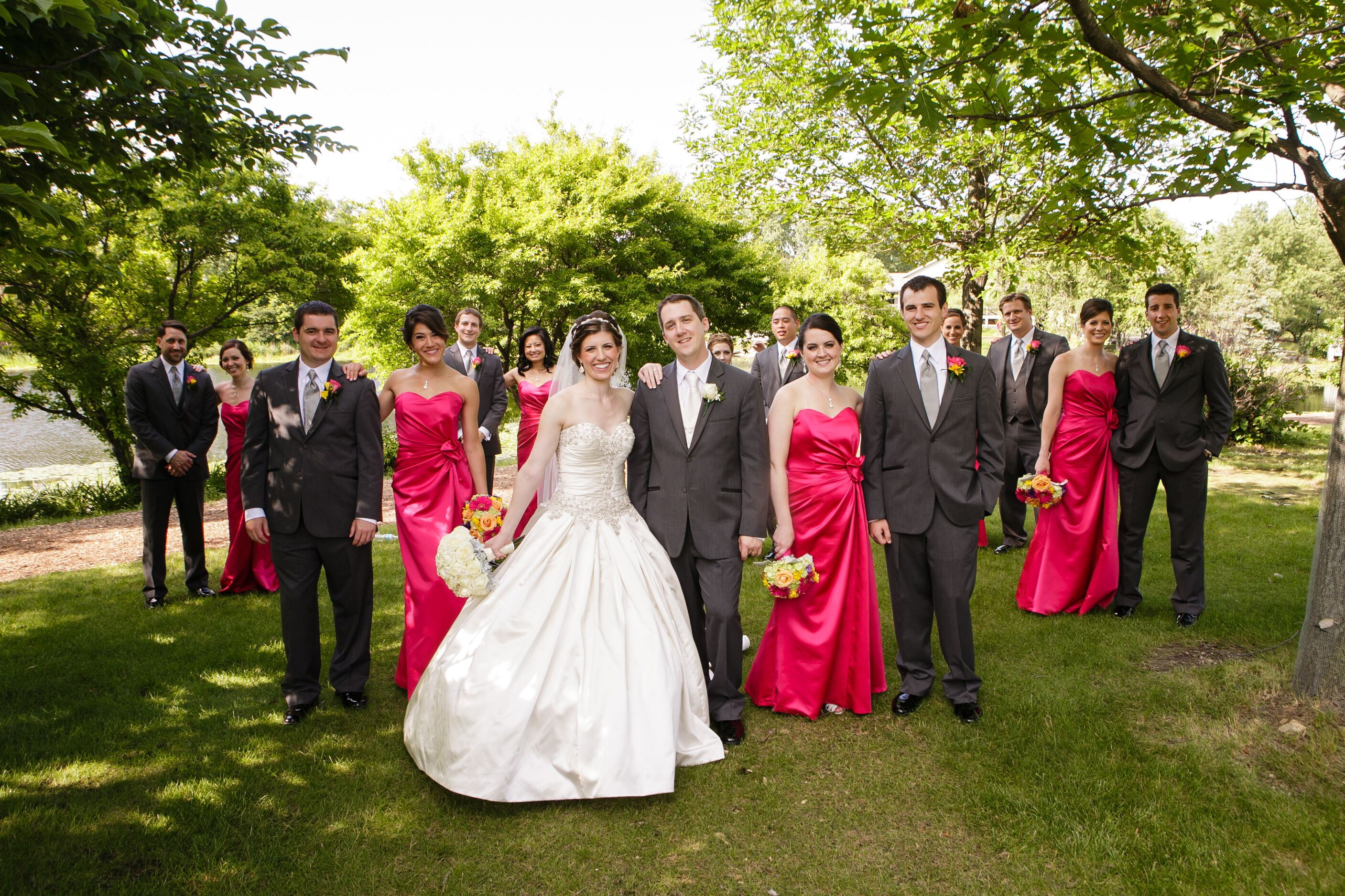 The Wedding Party In Hot Pink Floor Length Dresses And