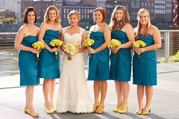 Rachel's bridesmaids matched in short teal dresses from Target with cheery yellow bouquets and accessories.