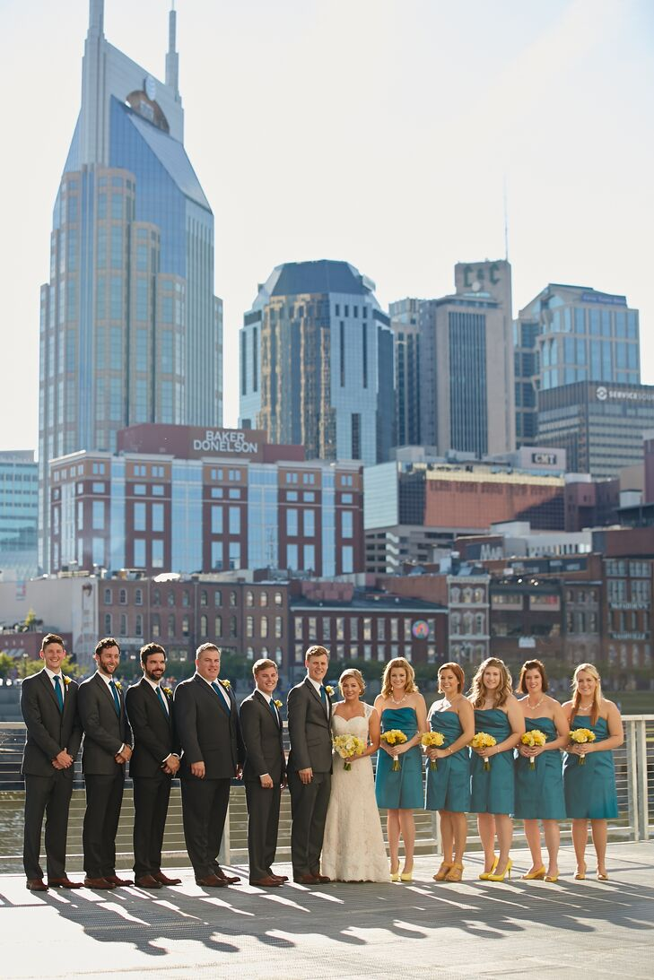 The groomsmen were gifted teal ties and tan wingtips to wear with their gray suits.