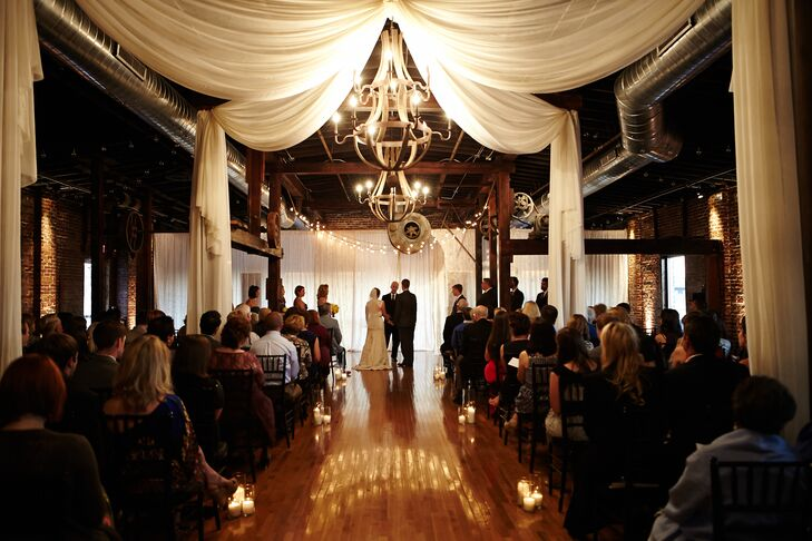 "The couple exchanged vows at Cannery One, a beautiful old factory that's been converted into event space. ""It had the perfect mix of wood floors, exposed brick walls and sweeping views of downtown,"" says Rachel."