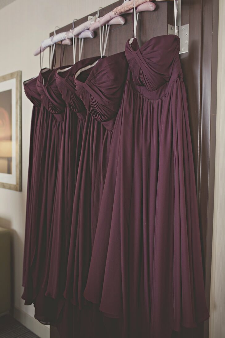 The bridesmaids wore convertible, burgundy chiffon dresses. I picked this particular dress because it was a flattering choice for every figure, age and style, says Emily.