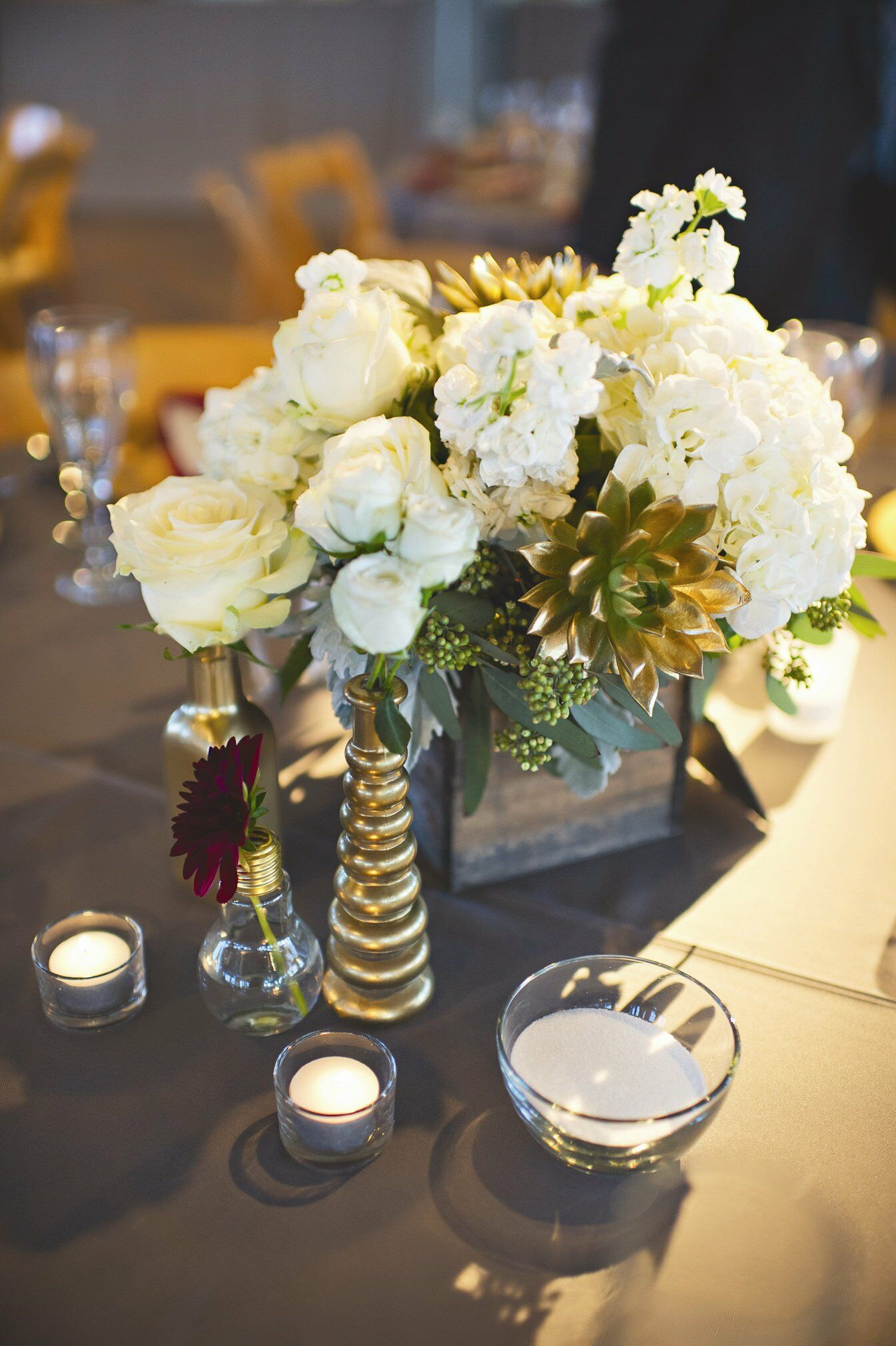 Rustic ivory and gold centerpieces