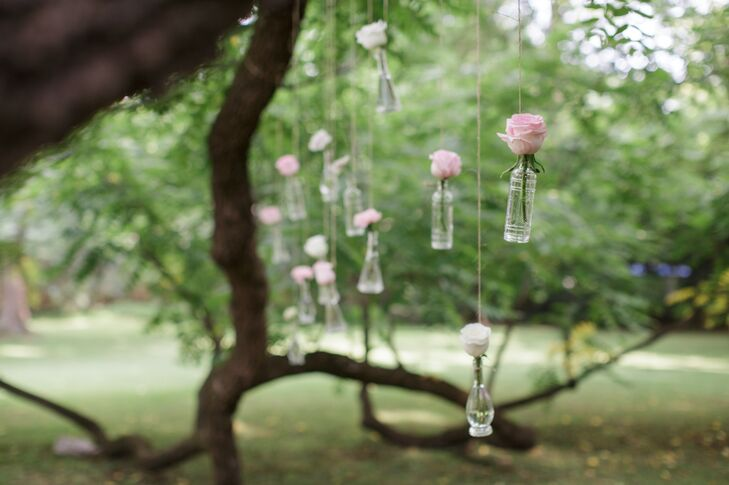 """Unfortunately for my dad, I love all things hanging,"" Kate says. ""With the help of family, he hung all the bud vases from the tree branch with twine for the ceremony. He also hung mercury glass mason jars and candles over the bridal table. So romantic."""