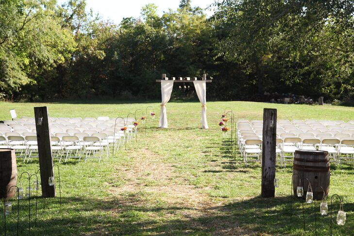 """I wanted to do a barn wedding but the places I looked at were not fitting into the budget,"" Melissa says. ""At work one day I was talking to a coworker about it, and she told me about the barn on her parent's property that she and a few of her siblings were married in. They currently rent it out on occasion. I went and looked at it and it definitely fit the budget so the venue was decided a year in advance."""