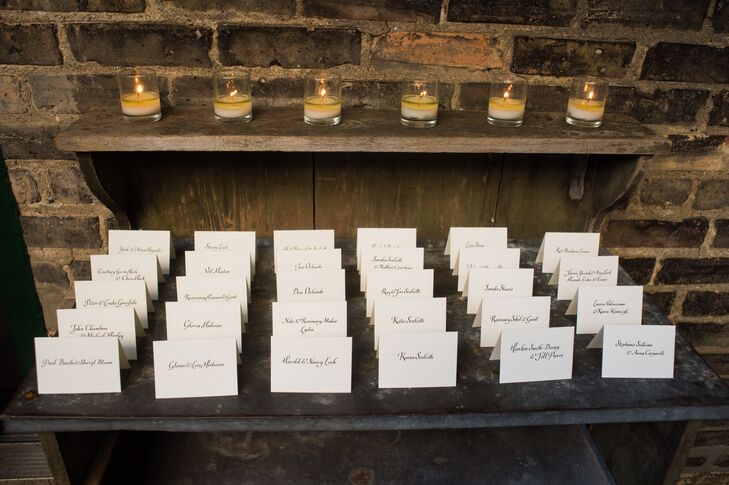 James and Stephen arranged the traditional escort cards on a table with a line of votive candles.