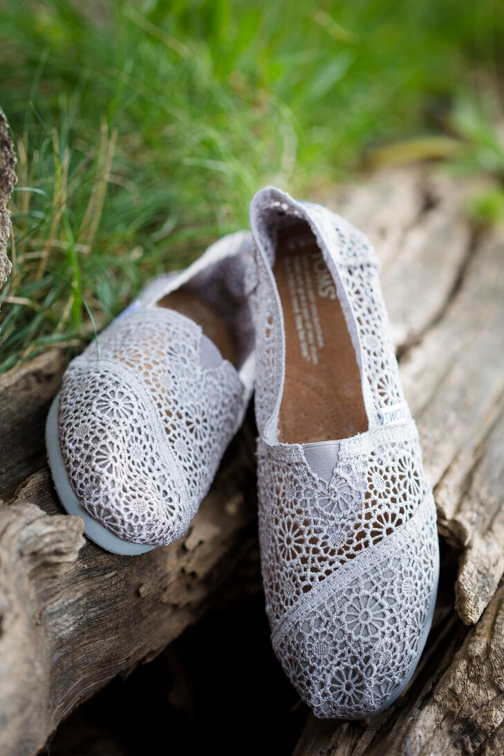 What we love is that the price of a pair of Toms bridal shoes won't make a huge dent in your wedding budget. That, and the delicate classic lace makes for a fantastic shoe shot. Hello — look at the gorgeous pics below! Toms also make a wonderful bridesmaid thank you gift.