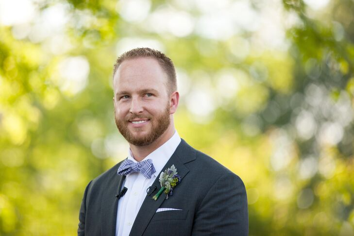 Greg sported a purple plaid bow tie over his white collared dress shirt. He had a boutonniere accented with dusty miller and lavender pinned to his charcoal gray jacket lapel.