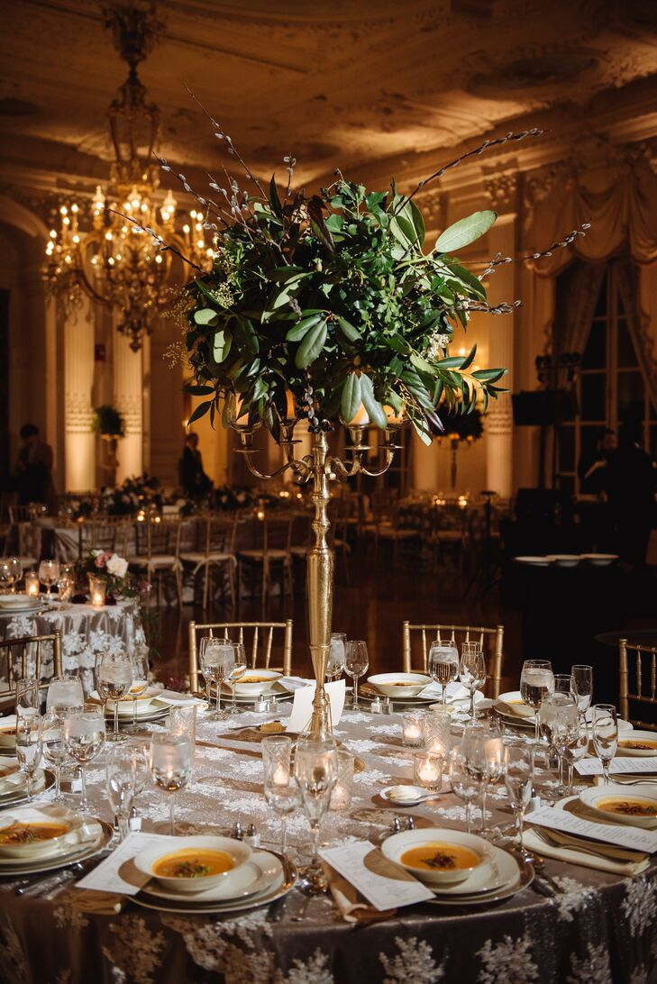 Tall Mixed-Greenery Centerpieces on Gold Candelabras