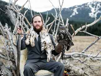 Game of Thrones–inspired groomsman style with owl