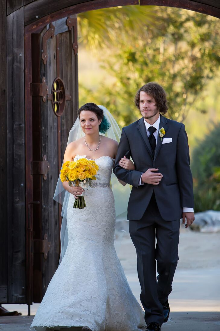 Lauren wore a lace mermaid style wedding dress with heart cutout cowboy boots for stylish comfort all night long.