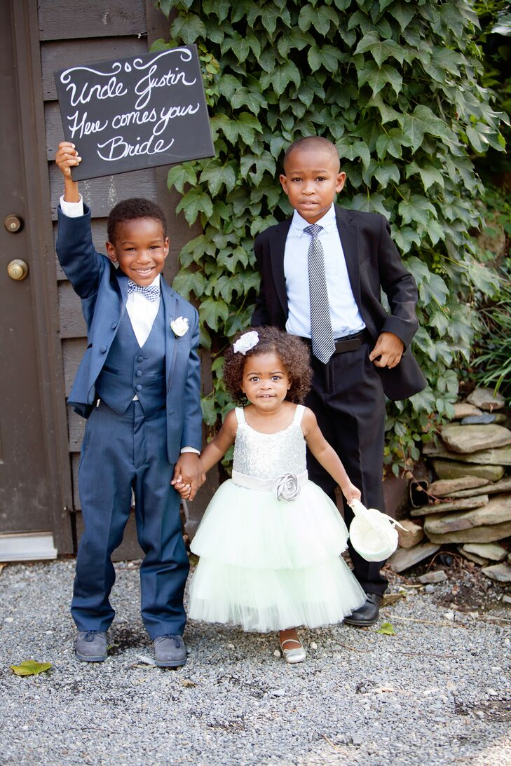 Formally dressed ring bearers and flower girl at a wedding
