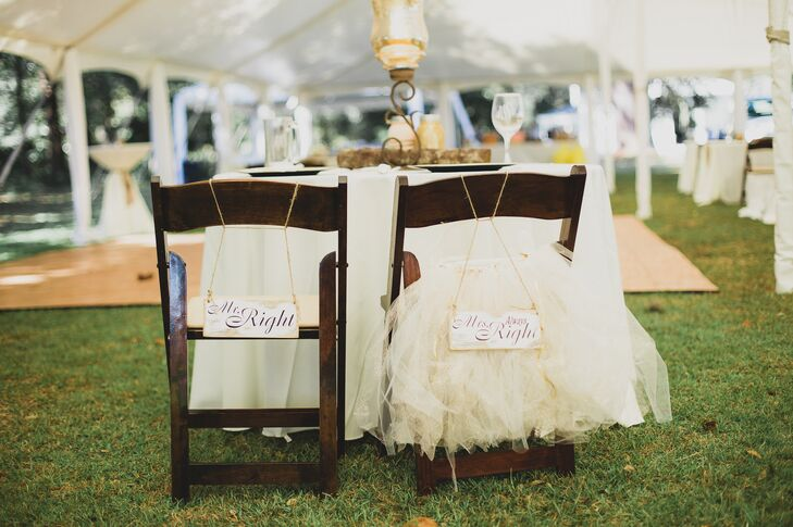 "Tangie and Mike marked their chairs at the reception with wood signs. They said, ""Mr. Right"" for him and ""Mrs. Always Right"" for her. To add a little extra bridal flair, they added a little tulle tutu skirt to Tangie's chair."
