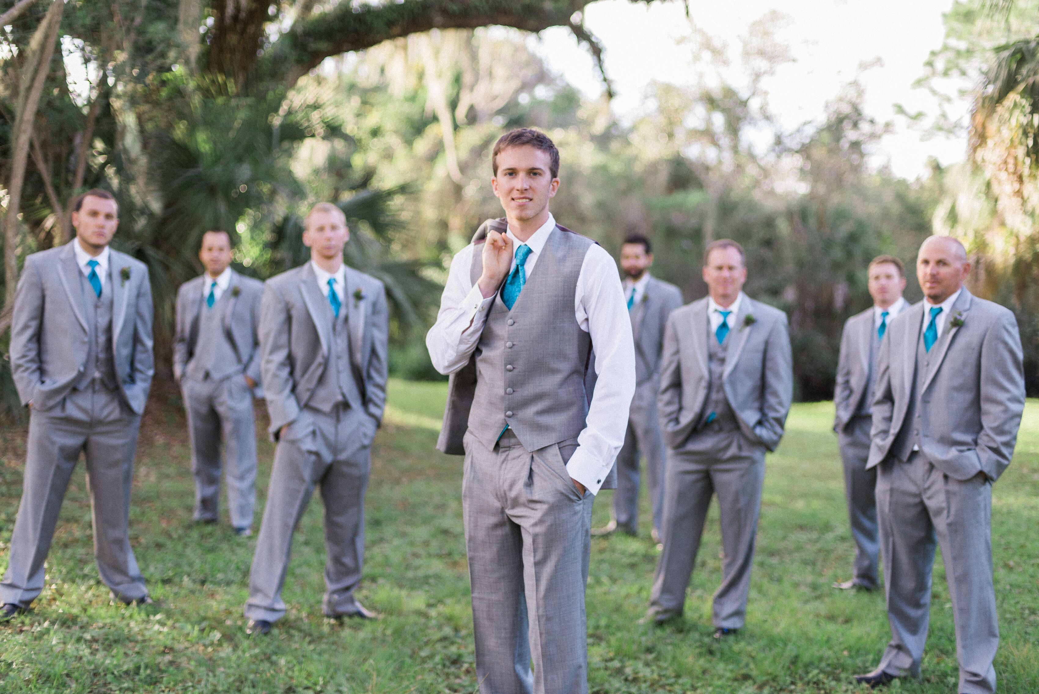Gray Groomsmen Suits With Bright Turquoise Ties