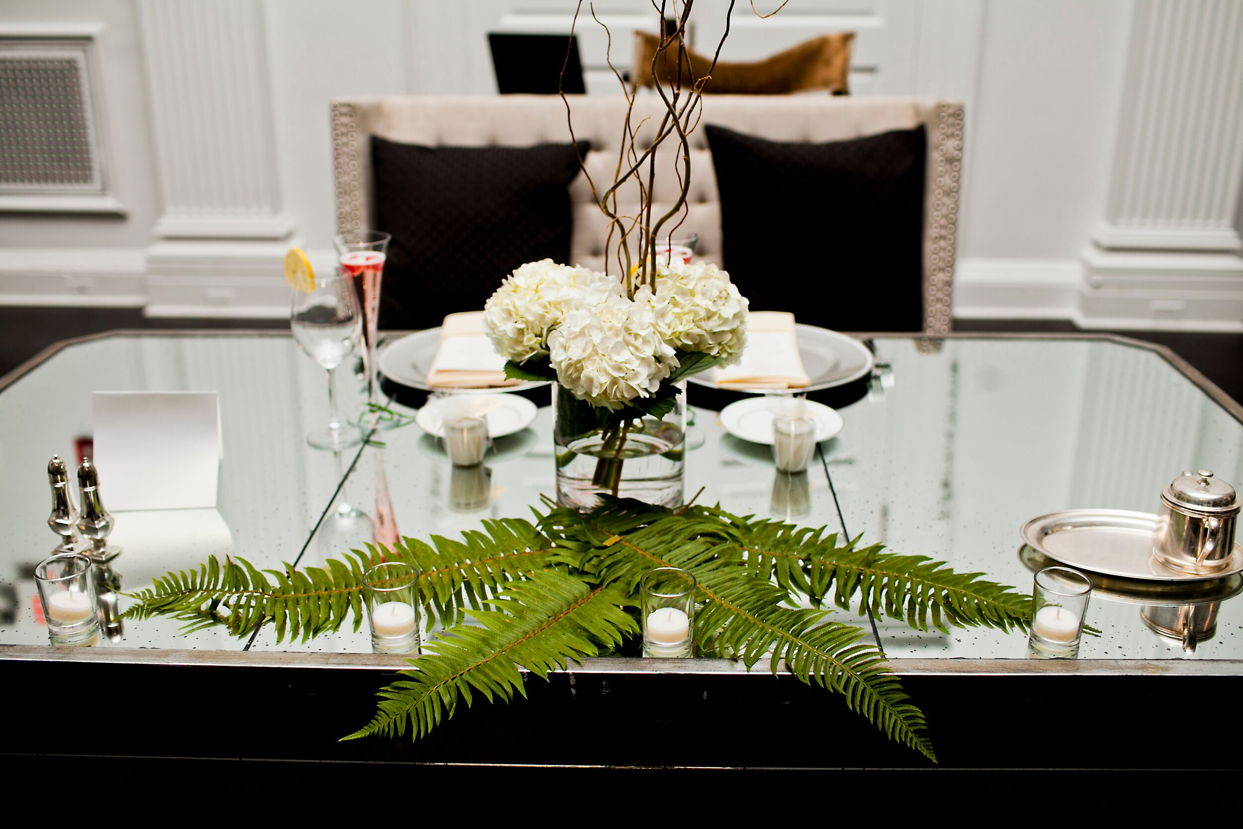 Centerpieces with curly willow branches hydrangeas and ferns