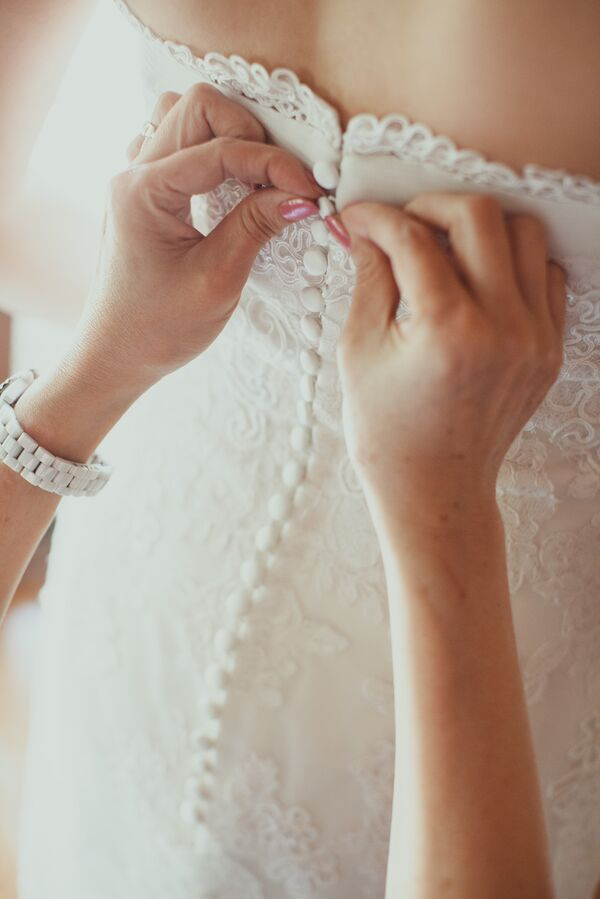 Buttoning Up Back of Wedding Dress
