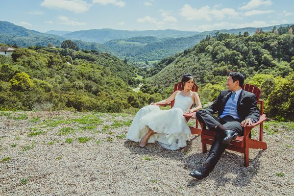 Couple Sitting With Natural Backdrop