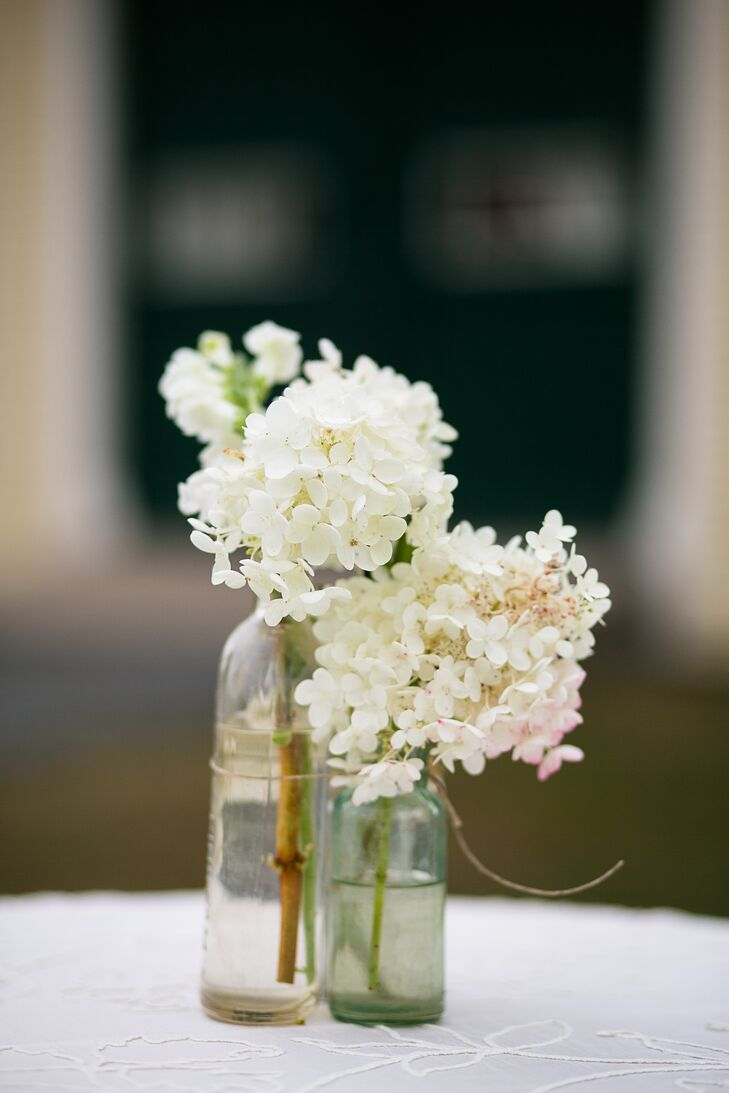 The couple celebrated their cocktail hour inside Laudholm Farm's barn as guests enjoyed mini grilled-cheese sandwiches, french fry cones and lobster bisque shooters. Caitlin and Mike decorated the space with white linen-covered cocktail tables and simple white hydrangea centerpieces in bulb glass vases.
