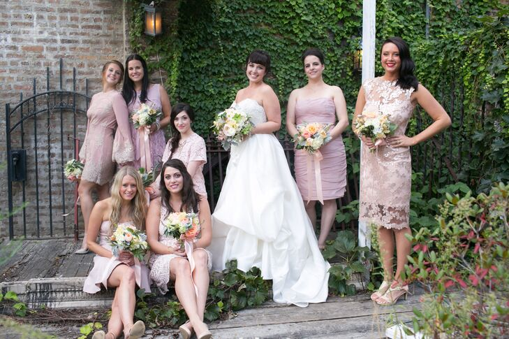 """Since Salvage One is such a unique venue, we let our groomsmen and bridesmaids choose whatever suit or dress they wanted. We gave them a color palette — gray for the guys, blush for the girls — and let them go wild!"" says Rachel. The result was stunning. The mix of textures, fabrics and styles felt modern, yet elegant, with the common blush color keeping the look cohesive.rn"