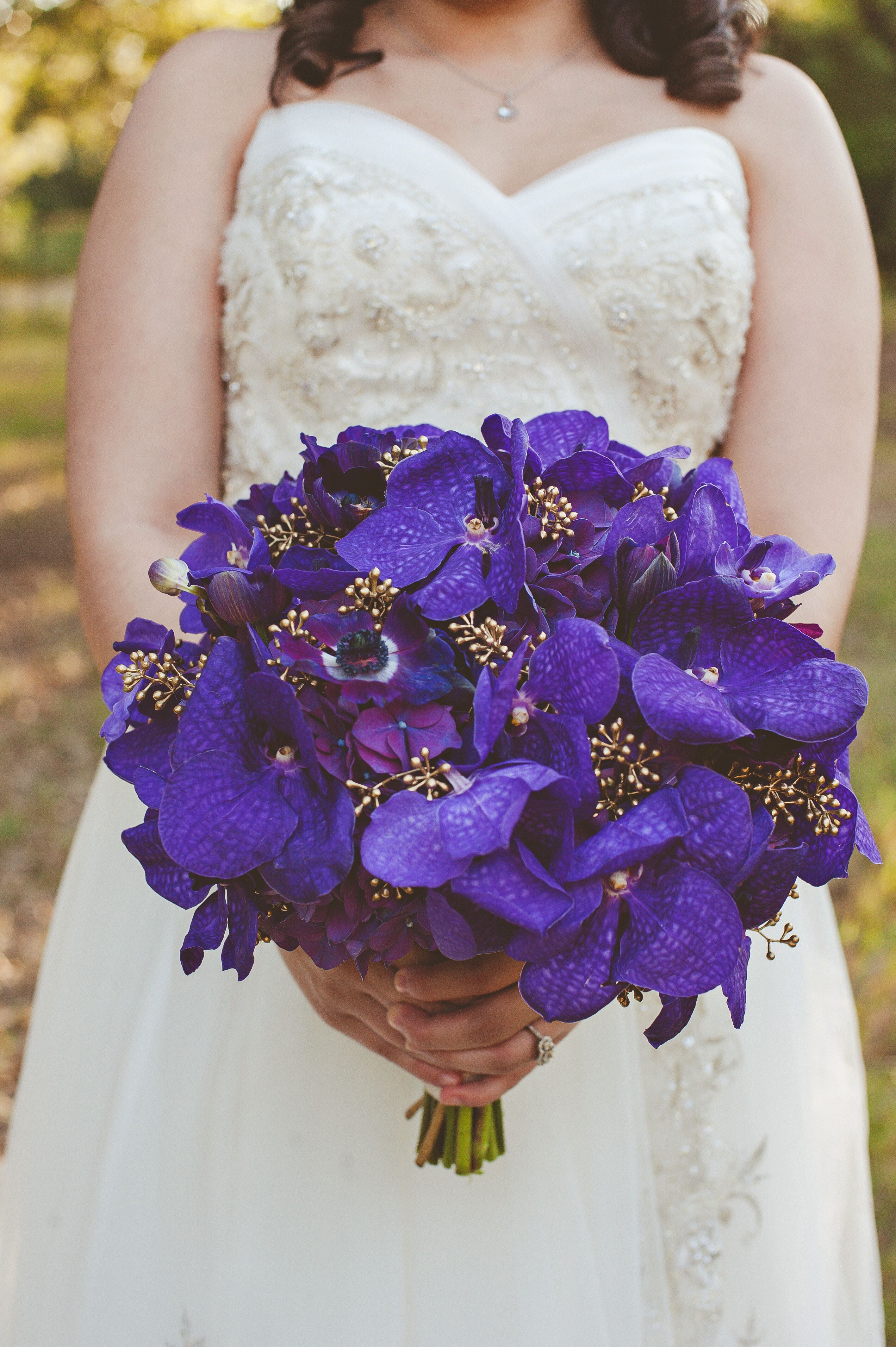 Purple wedding flower arrangements purple orchid and anemone bouquets izmirmasajfo Choice Image