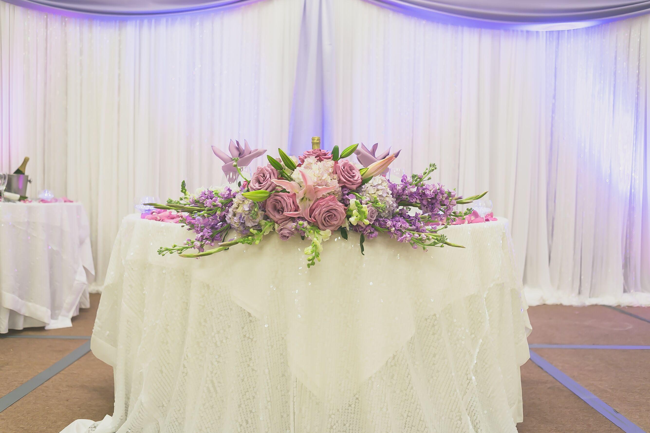 Cascading Purple Flower Sweetheart Table Centerpiece