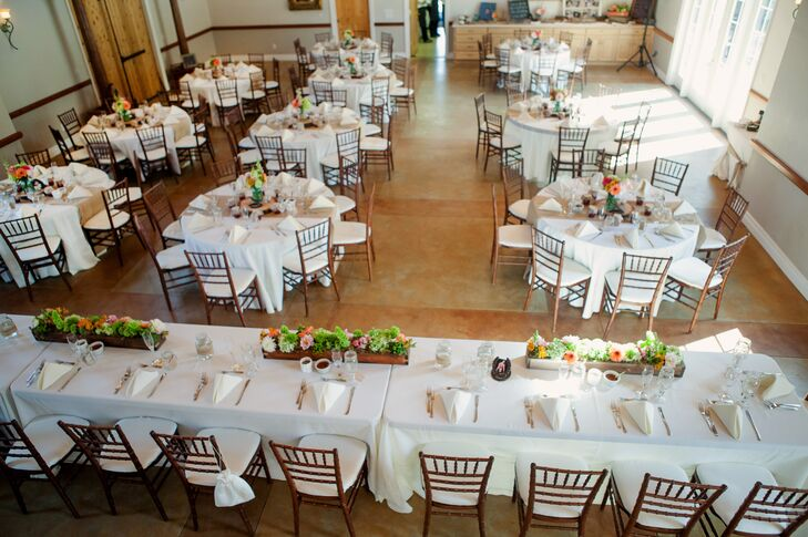 The reception was held inside the barn at Oaks Ranch, which had was a spacious venue with wooden floors and tables dressed in white linens.
