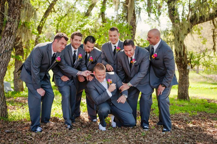 Groom Kneeling With Groomsmen