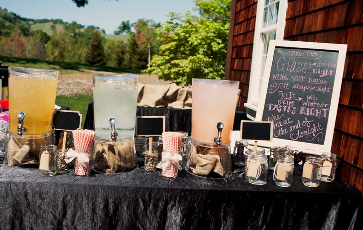 In addition to wine and beer, there was a mixed drink table set up for guests to enjoy. Mason jars were placed on the table for guests to use for the night, with a sign that explains the idea.