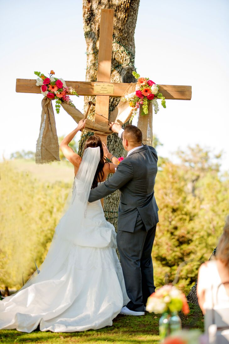 Instead of a unity candle, the couple performed a cross ceremony with a 12-foot cross that Ryan and Stacey had performed in the past.