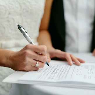 Signing papers on wedding day