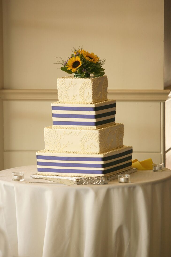Navy Wedding Cake Topped With Sunflowers