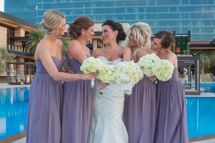 Kelle's bridesmaids wore soft purple floor length silk gowns purchased through Nordstrom's evening wear. Their bracelets and earrings were by Nadri.