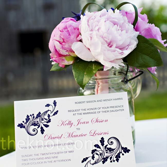 Kelly and Dave designed their invitation suite on their home computer and had the pieces printed professionally with navy and fuchsia soy-based inks. Kelly made envelope liners with lokta, or rice, paper from a local shop, which she trimmed to fit the envelopes.