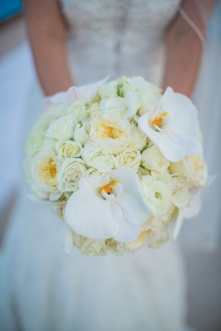 Kelle's bouquet was a combination of cream hydrangeas, lilies, roses and garden roses with white orchids.