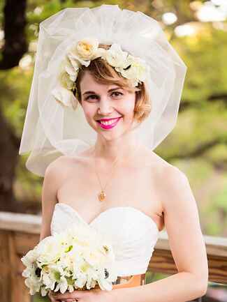 Wedding flower crown styled with a veil