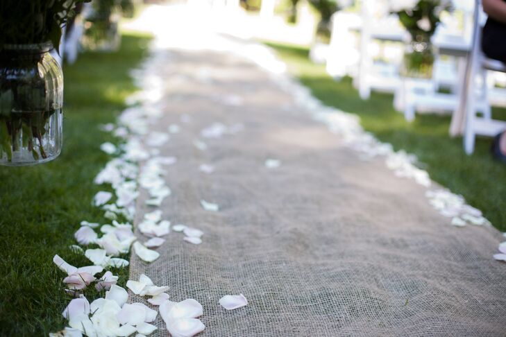 Loose Petals on Cobblestone Wedding Aisle