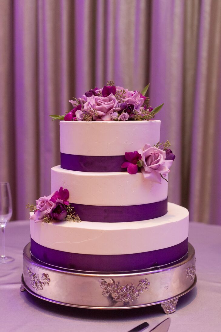 Wedding Cake with Purple Ribbon and Scattered Flowers