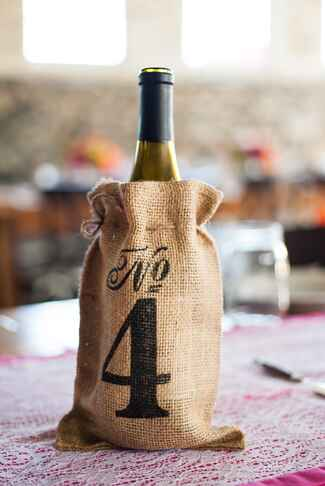 Stenciled burlap wine bag table number