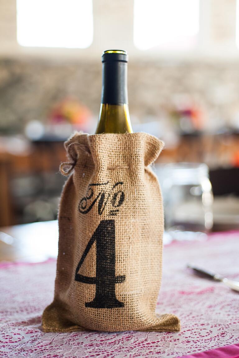 Stenciled burlap wine bag table number