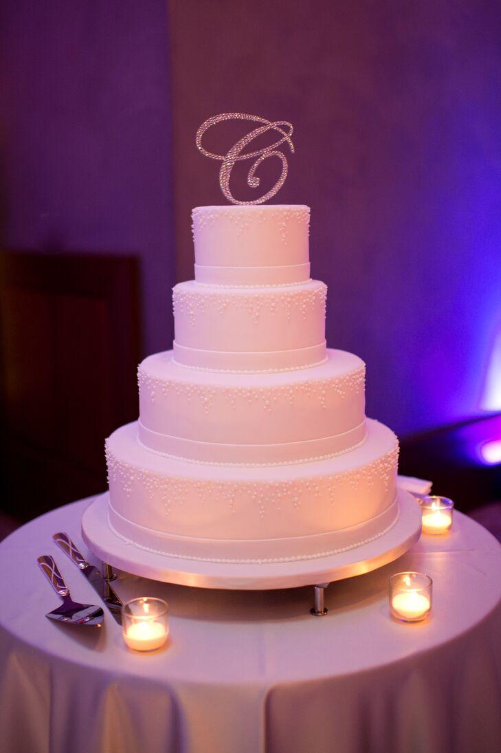 White Wedding Cake With Monogrammed Cake Topper